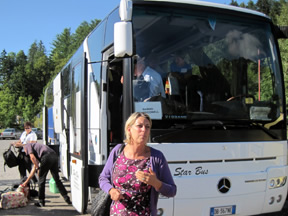 Nawas Tour Director Elizabeth supervises the unloading of a tour bus in Oberammergau